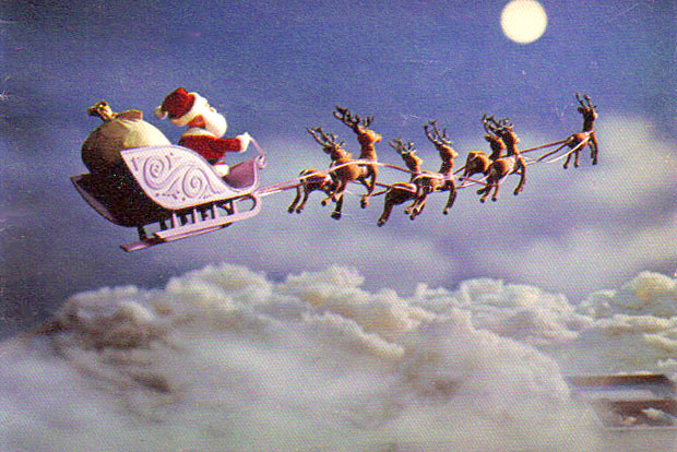 Santa-Claus-on-his-sleigh-desktop-Wallpaper
