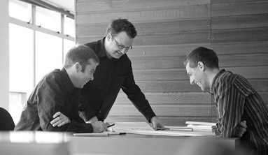 Cymon Allfrey with clients at his archtiecture firm.