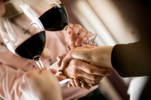 Networking is better with wine ... just ensure your hands aren't too full at that pivotal moment!